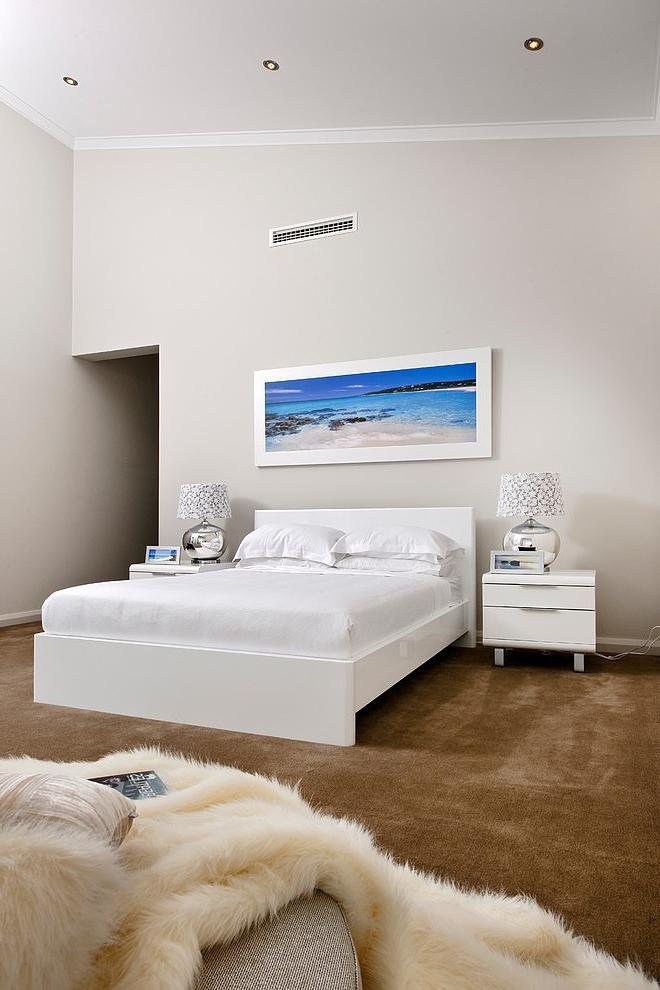 White bedroom design in a home near the ocean shore