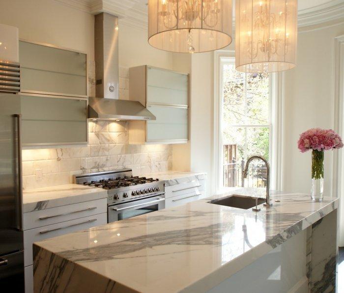 White kitchen design with floor-to-ceiling windows