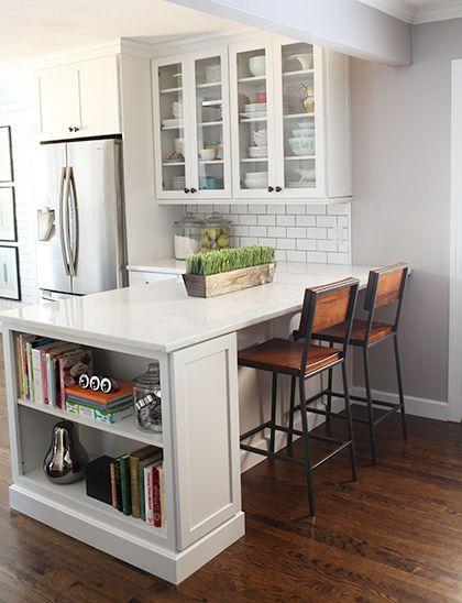White kitchen design with modern bar stools