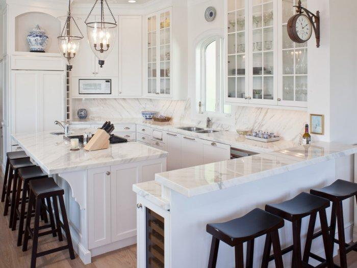 White kitchen interior with marble countertops
