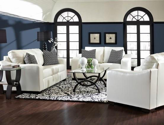 White leather sofas in a traditional home