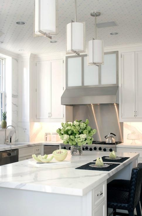 White marble countertops in a modern kitchen