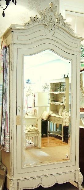 White mirror door in a closet