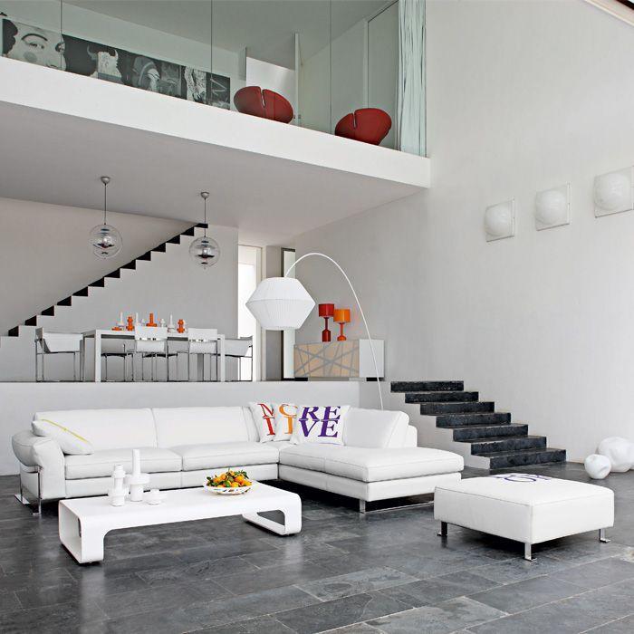 Whtie corner sofa in a contemporary loft