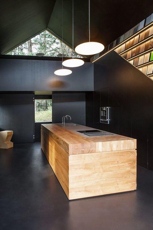 Wood kitchen island in a dark colored interior