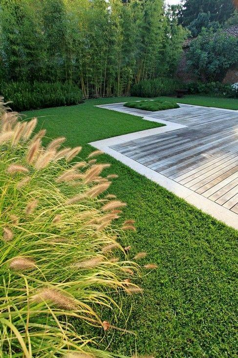 Wooden deck and grass outside the house