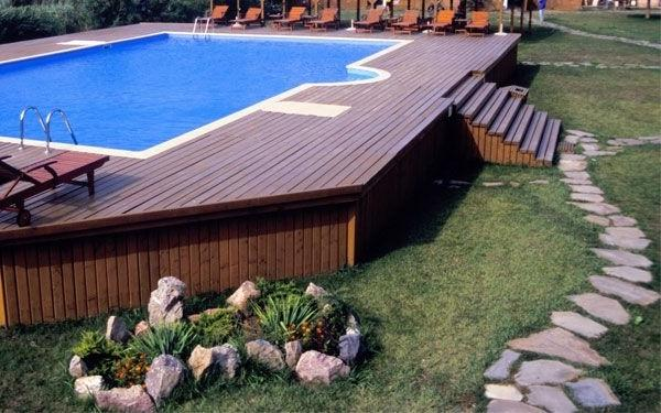 Wooden deck and outdoor swimming pool