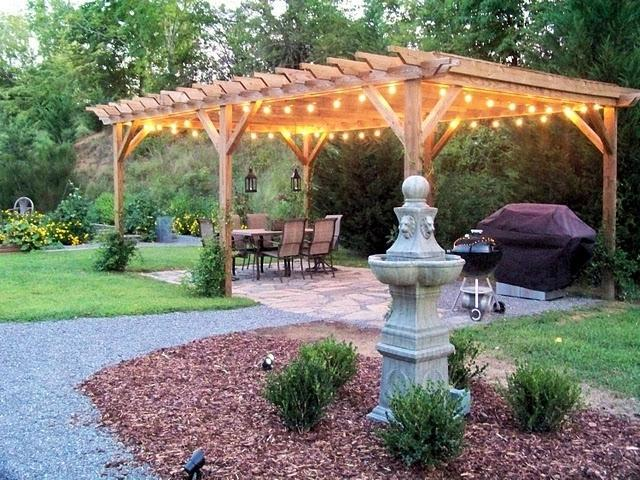 Woord Pergola With Light Bulbs For Evening Parties In The Dark