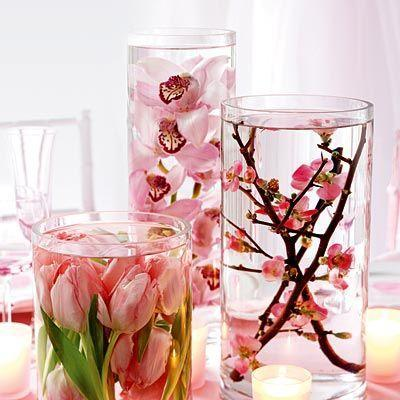 1 - Flowers inside vessels full of water and placed on a table