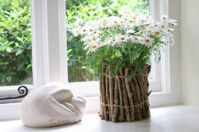 9 - Fresh lawn flowers in a vesel made of natural branches wrapped together