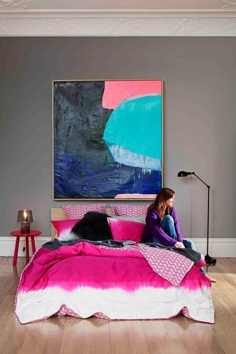 Abstract painting hanged above the bed in the apartment