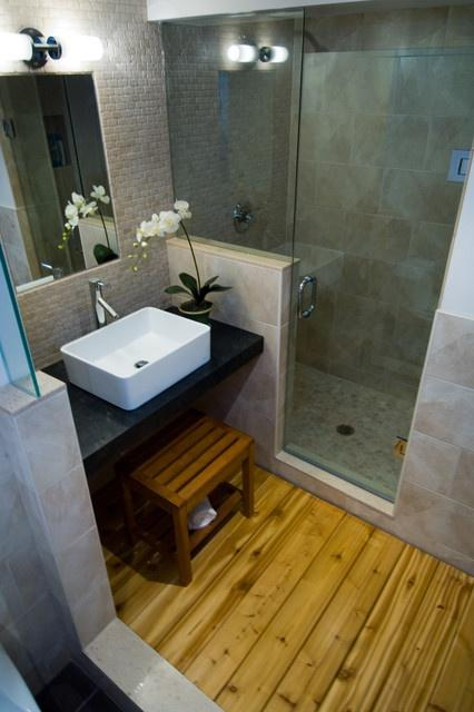 Apartment bathroom with wood floor