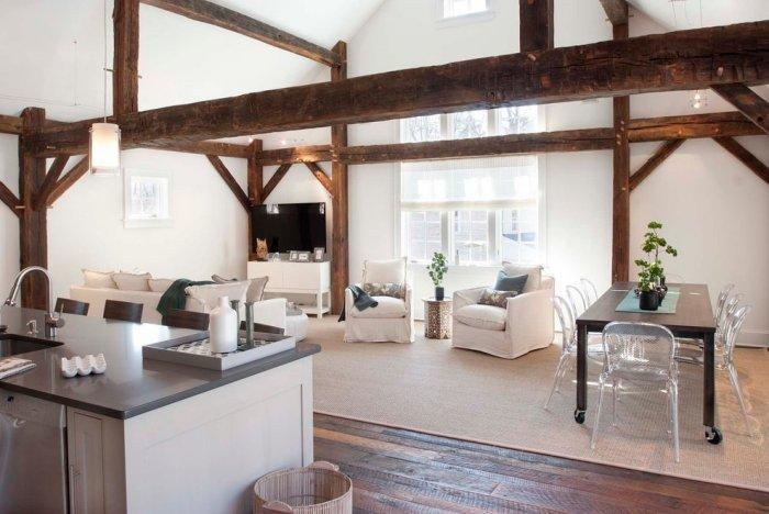 Barn open plan interior - with beams on the ceiling and modern furniture
