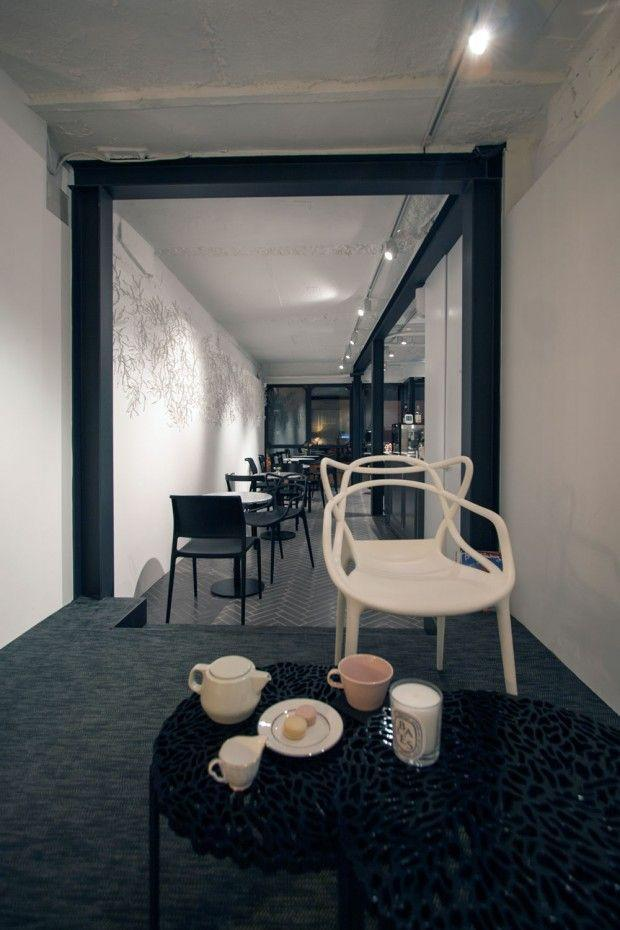Cafe in china with black and white interior design for Interior house designs black and white