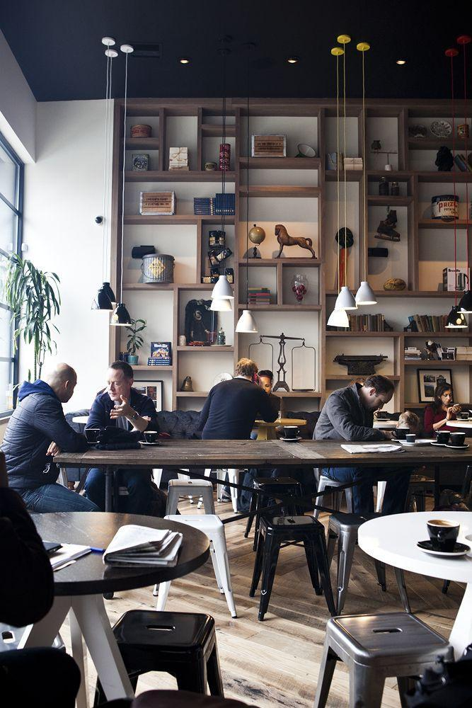 cafe in milan with modern interior and wood shelves - Gray Cafe Interior