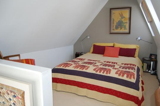Casual attic bedroom - with modern bedsheets