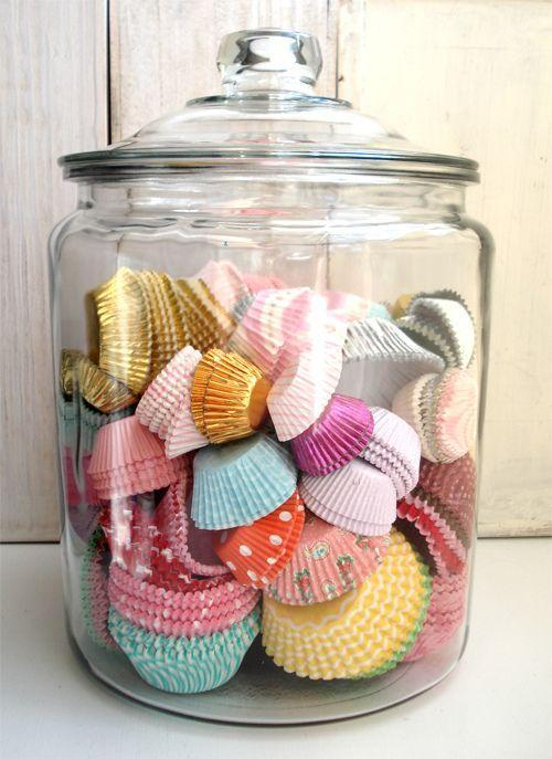 Colorful candy paper cups placed in a hurricane jar