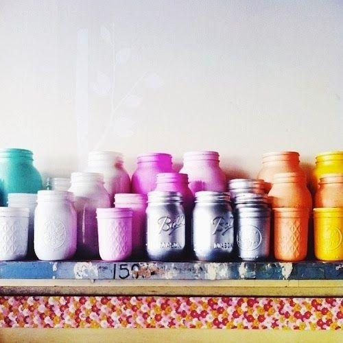 Colorful jars placed on the fireplace mantel