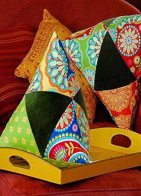 Colorful pillows of various colors and patches of styles