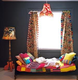 Colorful room with funny bed sheets and curtains