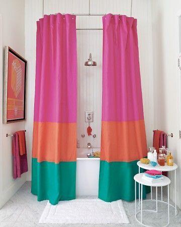Colorful shower curtains placed in the apartment bathroom