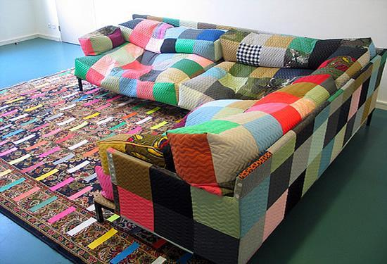 Colorful sofa and graphic rug of patterns of patches