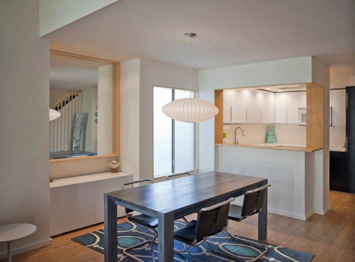 Contemporary dining room - with very stylish modern dinner table