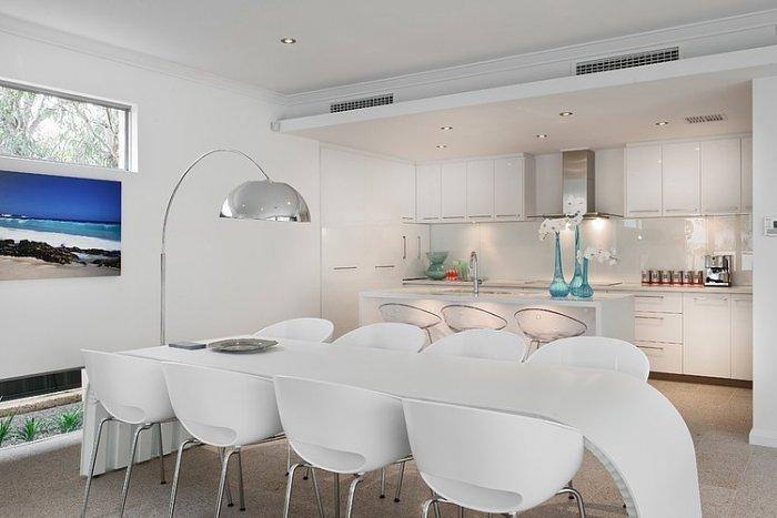Contemporary dining room with white table and chairs