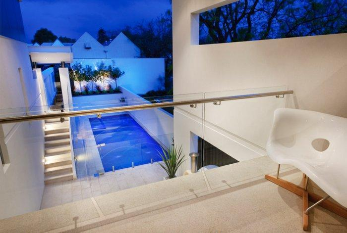 Contemporary terrace overviewing the swimming pool on the ground floor