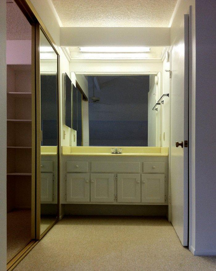 Contemporary white bathroom - with stylish square mirror