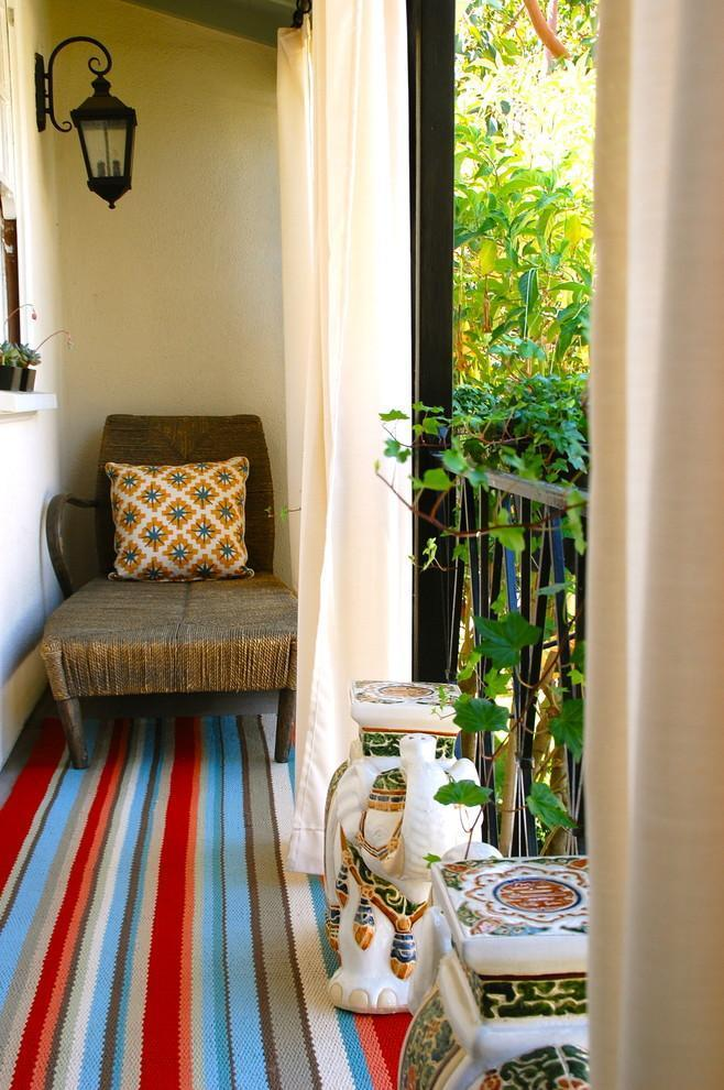Cozy small balcony with colorful rug