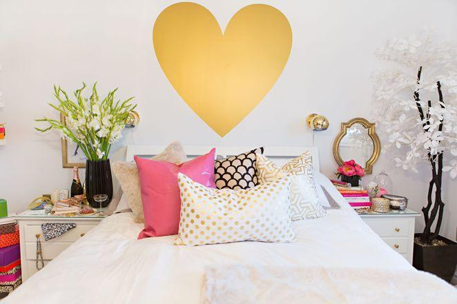 Decorative heart decall placed on the wall above the bed