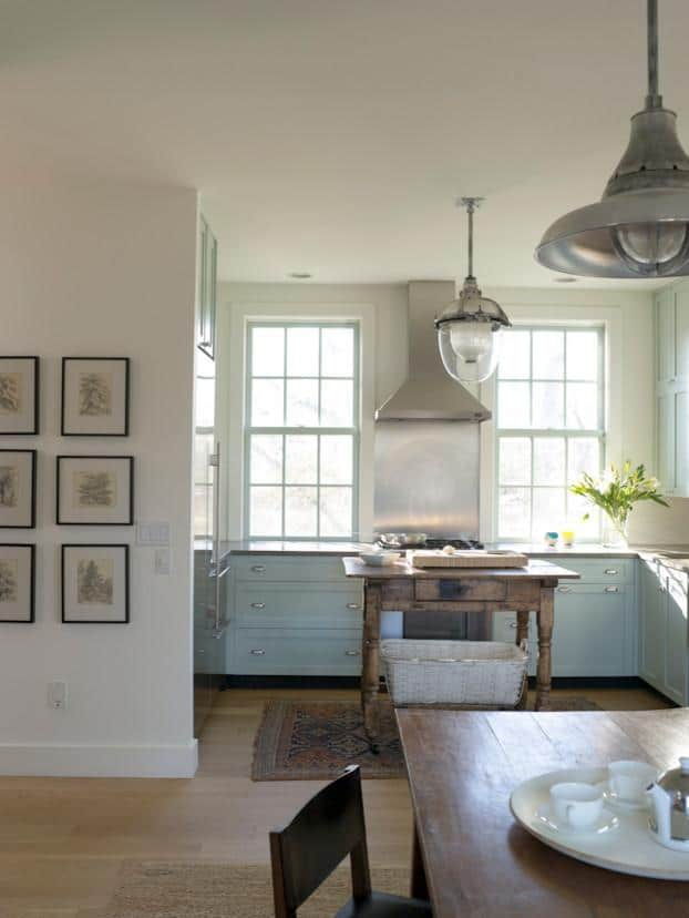 Eclectic kitchen - with small stove and modern pendants
