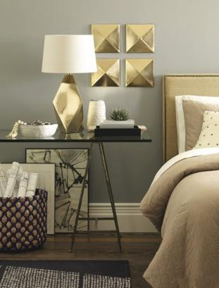 Home decor - golden accents in the bedroom decorate the wall