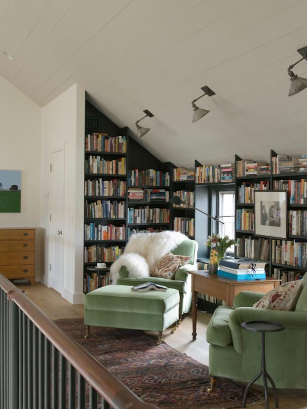Home library - with bookshelves and comfortable armchairs