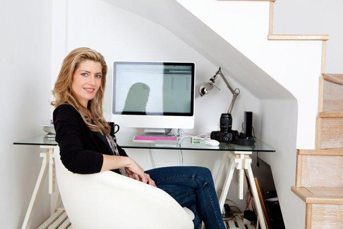 Home office beneath the stairs - with glass desk and modern chair