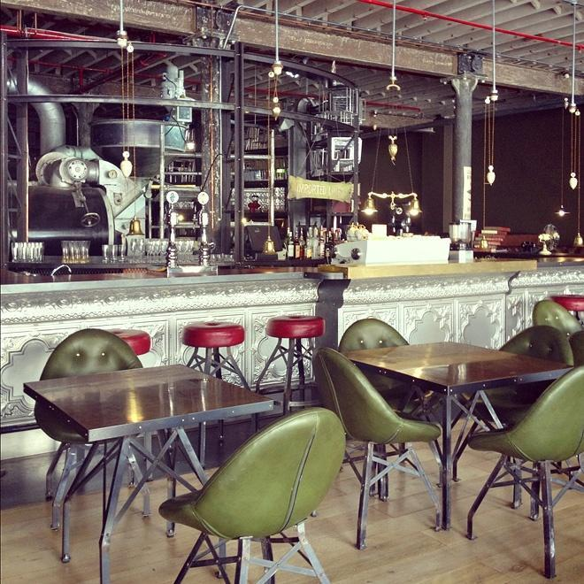 Industrial cafe interior - with green chairs and red bar stools
