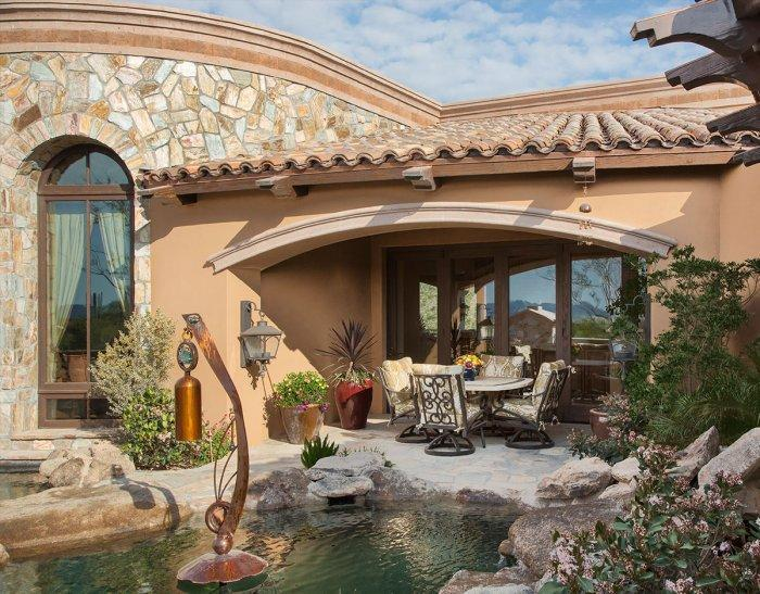 Luxurious traditional garden - with small pond and patio furniture