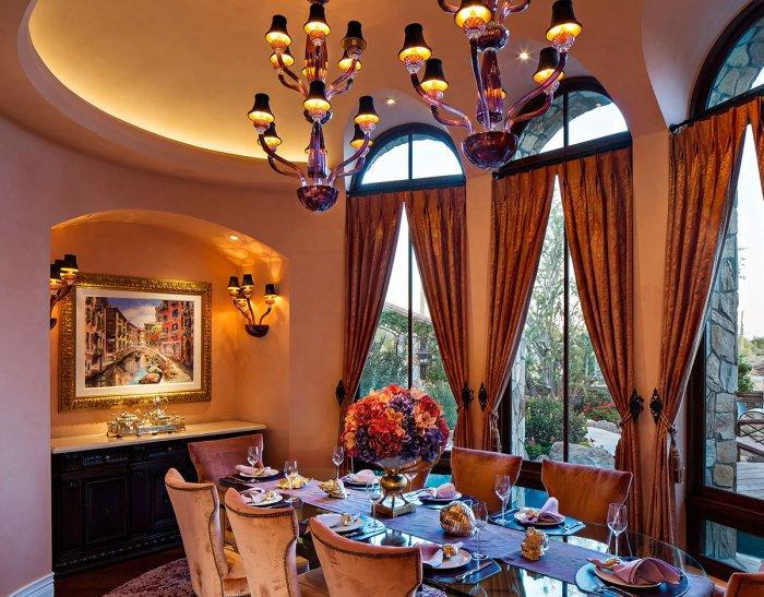 Luxurious tradtional dining room - with arched windows and art pendants