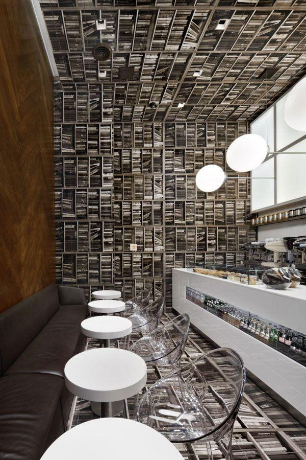 Modern Cafe In New York With Bookshelves And Lots Of Books