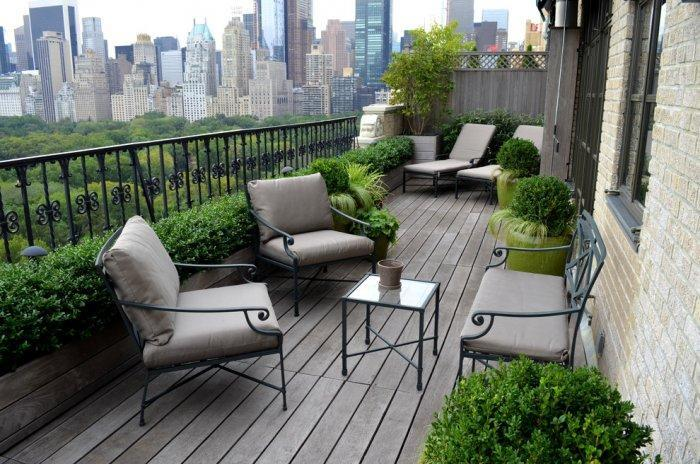 Modern balcony in New York with green bushes