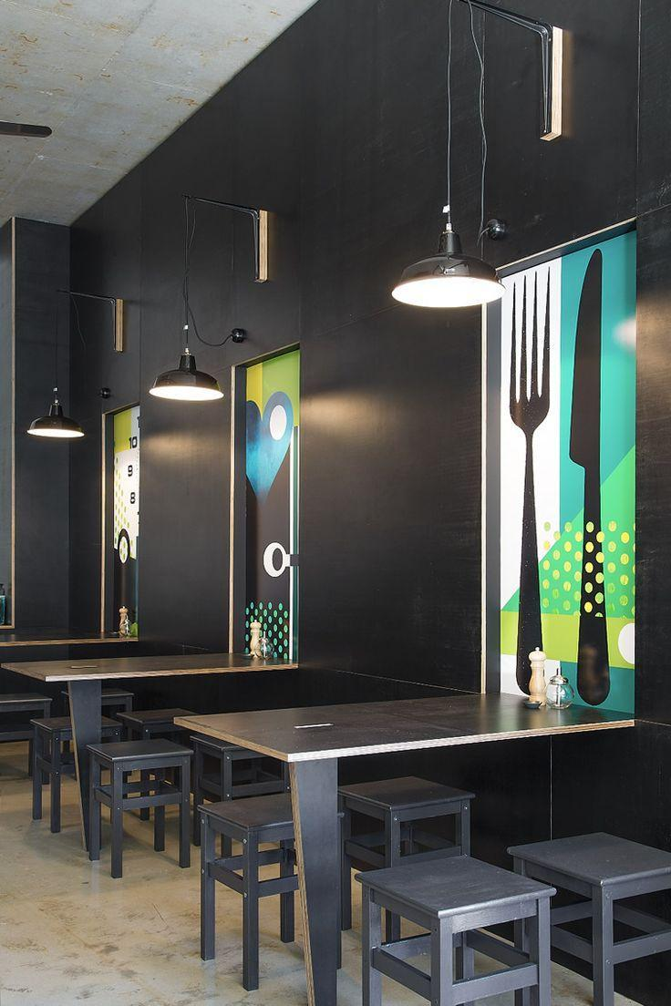 Modern office canteen with interesting wall decorations