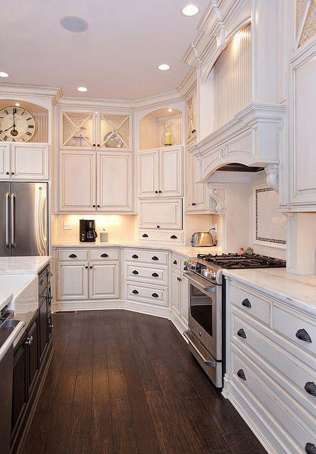 Modern traditional cabinets - in a white spacious kitchen