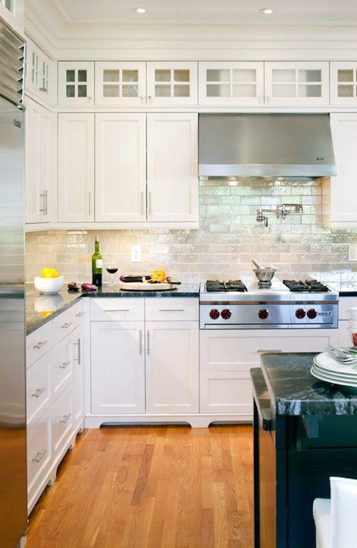 Modern white cabinets - in a moderate kitchen design
