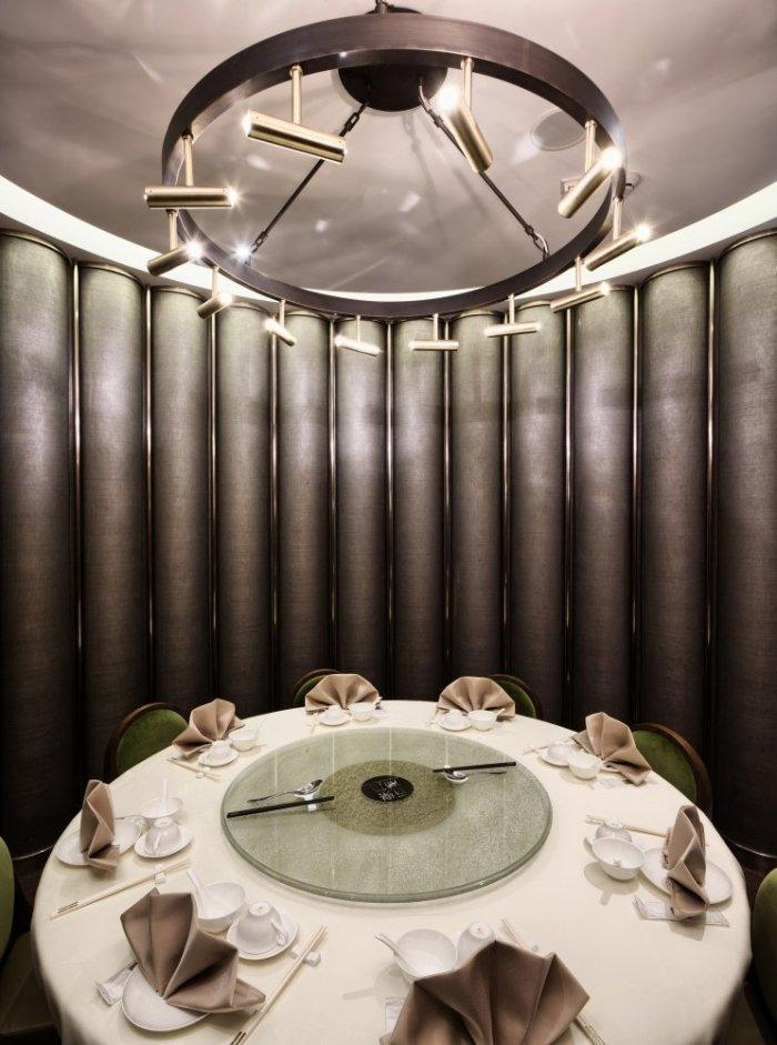 Restaurant architecture - a round table inside a private room with oval shape