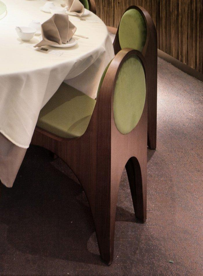 Restaurant architecture - comfortable wooden chairs for the tables