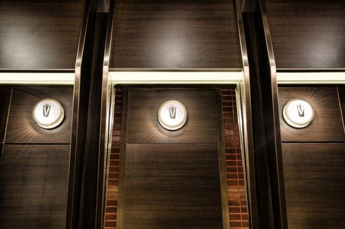 Restaurant architecture - the modern lights complete the wooden wall panels
