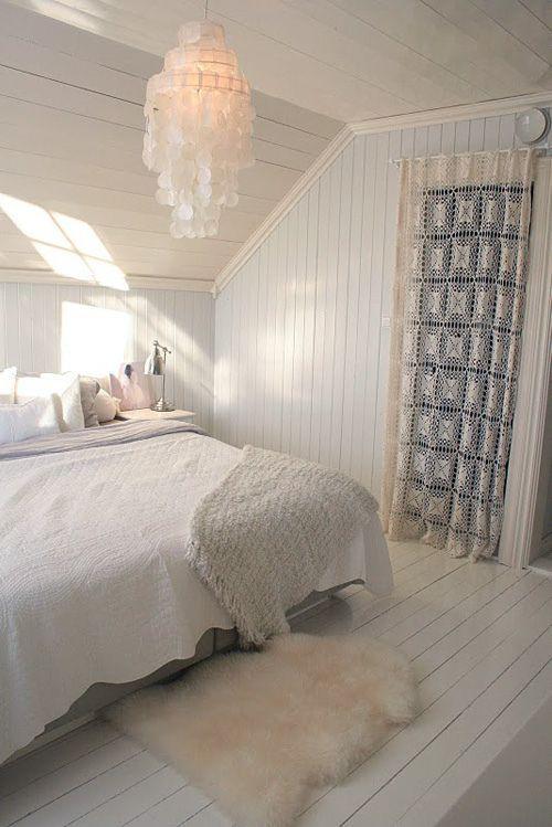 Scandinavian attic bedroom - with interesting crystal chandelier