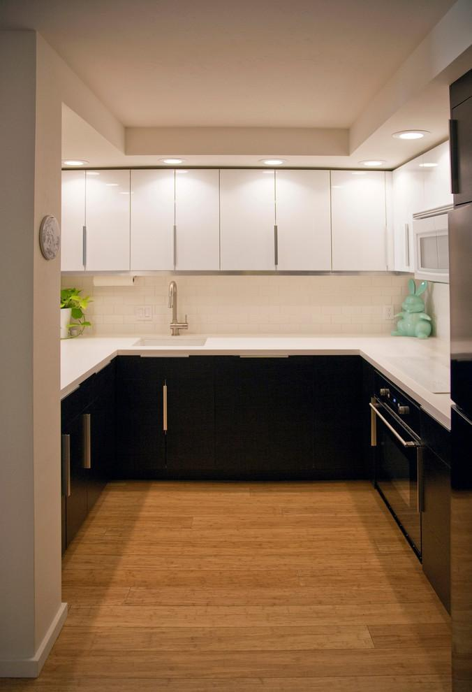 Small contemporary kitchen - in white and black colors