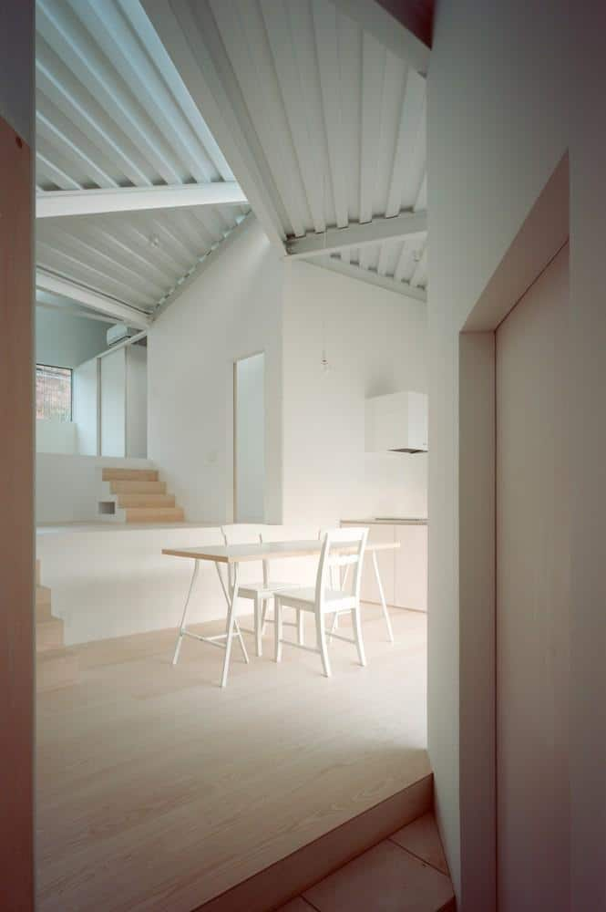 Small minimalist house and its dining room in white color